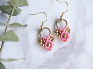 Closeup Pair of pink color Arya macrame earrings made from raw brass.