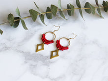 Load image into Gallery viewer, Side view of Red Hollow diamond style drop macrame earrings in white background.