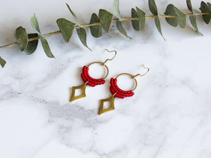 Side view of Red Hollow diamond style drop macrame earrings in white background.