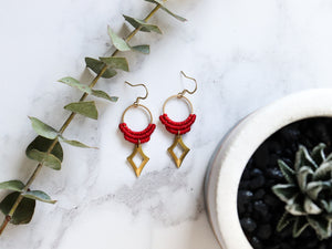 Top view of Red Hollow diamond style drop macrame earrings in white background.