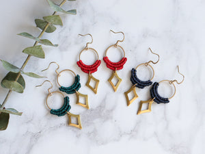 Three pairs of Hollow diamond style drop macrame earrings in red, green and blue color.