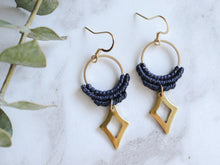 Load image into Gallery viewer, Closeup of blue Hollow diamond style drop macrame earrings.