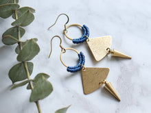 Load image into Gallery viewer, Sideview of Pair of Handmade Brushed triangle with spike macrame earrings in golden and blue color.