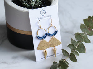 Pair of Handmade Brushed triangle with spike macrame earrings in golden and blue color.