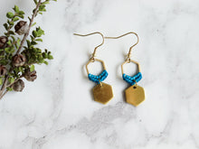 Load image into Gallery viewer, Closeup Mini hexagon style macrame earrings in blue and golden color.