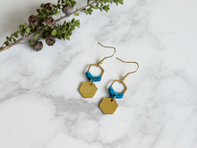 Load image into Gallery viewer, Top View of Mini hexagon style macrame earrings in blue and golden color.