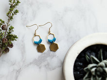 Load image into Gallery viewer, Topview of Mini hexagon style macrame earrings in blue and golden color.