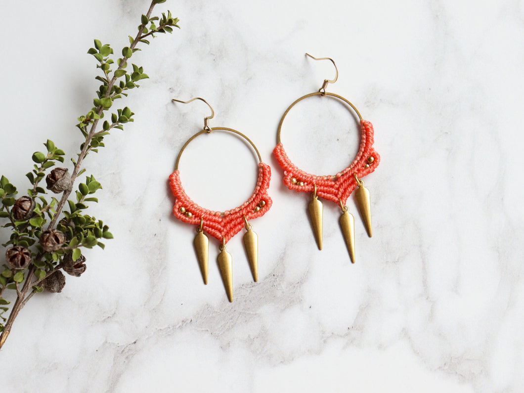 Pair of Dangly bolly Style macrame earrings in orange color Made with knotted waxed polyester and brass components.