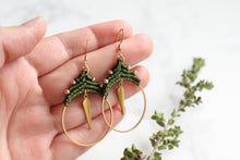 Load image into Gallery viewer, Hands holding Spike hoop style macrame earrings Made with knotted waxed polyester and brass.