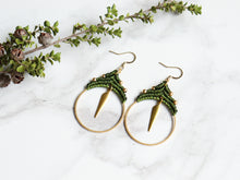 Load image into Gallery viewer, Side view of Spike hoop style macrame earrings Made with knotted waxed polyester and brass.