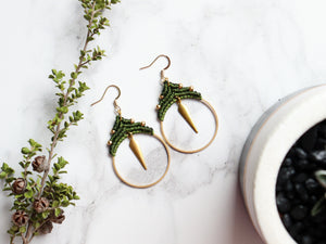 Top view of Spike hoop style macrame earrings Made with knotted waxed polyester and brass.