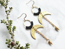 Load image into Gallery viewer, Sideview of Pair of Hammered style drop macrame earrings in gold and black color.