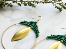 Load image into Gallery viewer, side view of Pair Big leaf hoop macrame earrings in gold and green color with white background.