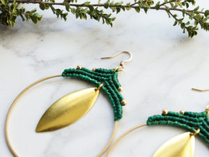 side view of Pair Big leaf hoop macrame earrings in gold and green color with white background.