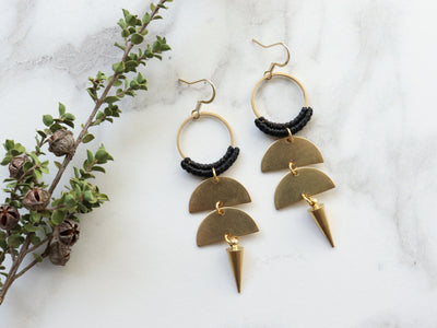 Pair of Double semi circle with spike shapped macrame earrings in black and gold color.