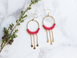 Pair of Dangly stars style macrame earrings in pink color Made with knotted waxed polyester and brass components.