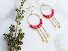 Load image into Gallery viewer, Sideview of Pair of Dangly stars style macrame earrings in pink color Made with knotted waxed polyester and brass components.
