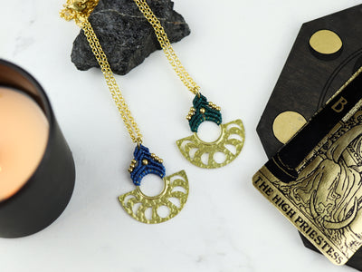 Comparison of Moon phase macrame necklace in blue and forest green.