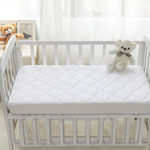 Deluxe Quilted Waterproof Crib Mattress Pad Waterproof Crib Pad ryan & emma bedding