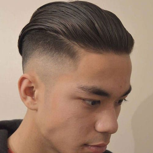 High Skin Taper Fade with Thick Slicked Back Hair