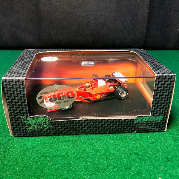 ferrari_f1-2000_michael_schumacher_n_3_by_hotwheels_1-43_(26748)-1_at_albaco.com