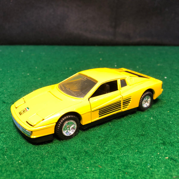 ferrari_testarossa_yellow_motorized_by_mc_toy_1-39_(no_box)-1_at_albaco.com