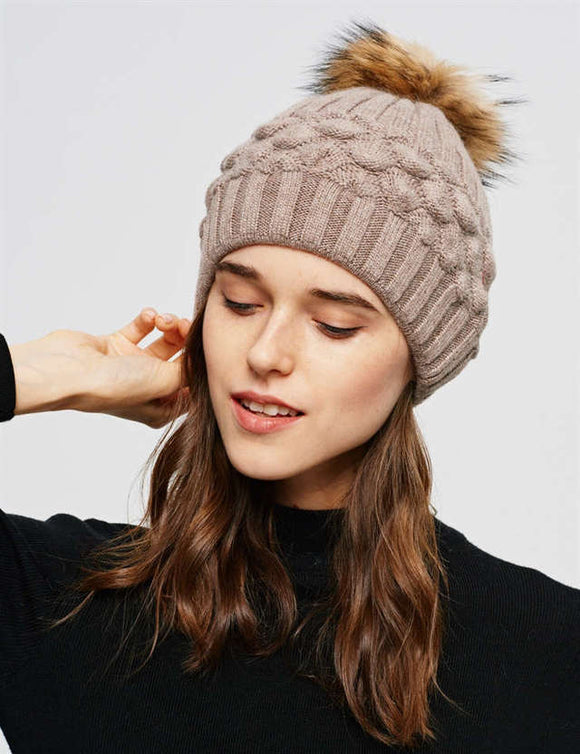 Beige hat with removable pom pom