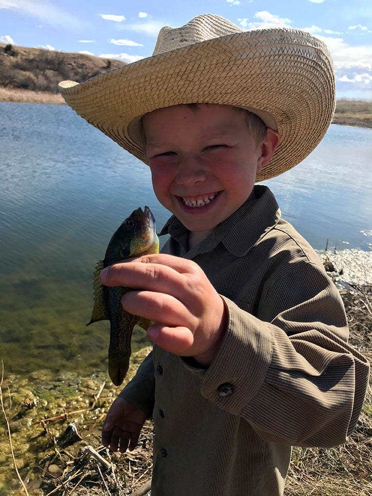 lincoln holding small fish