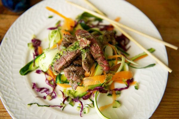 bison steak vietnamese salad on a white plate with chopsticks