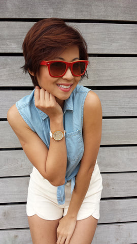 girl wearing red sunglasses and white watch