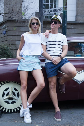 couple chilling on a vintage car's hood