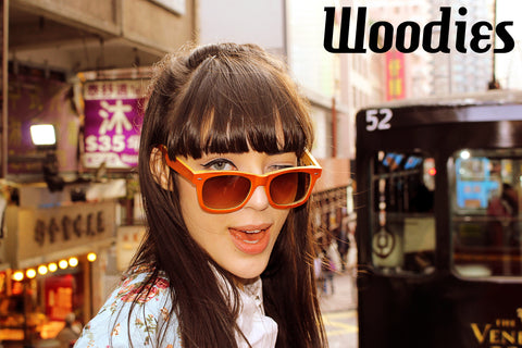 girl wearing orange sunglasses in the city