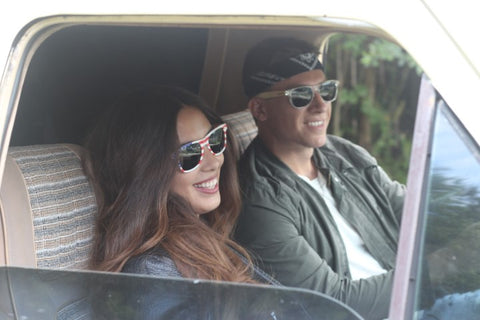 girl and boy in leather jacket and sunglasses driving