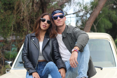 girl and boy in leather jacket and sunglasses