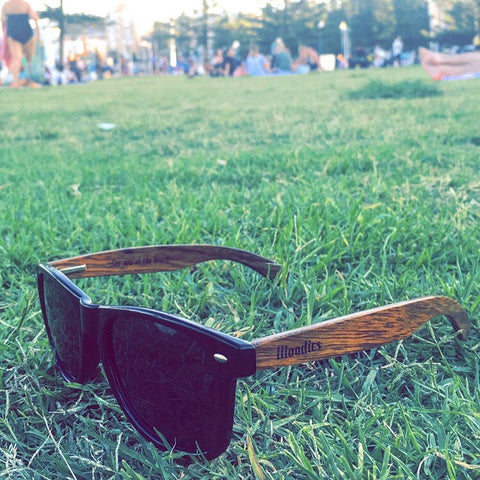 wood sunglasses in the grass