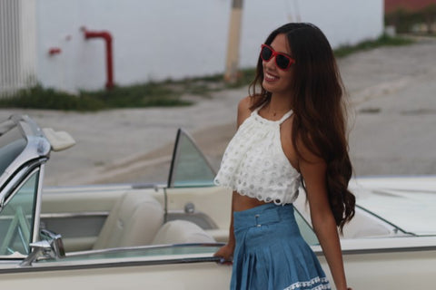 girl in white top and denim skirt