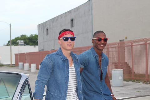 2 guys in sunglasses and denim polo hanging out