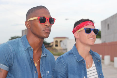 2 guys in sunglasses wearing denim polo