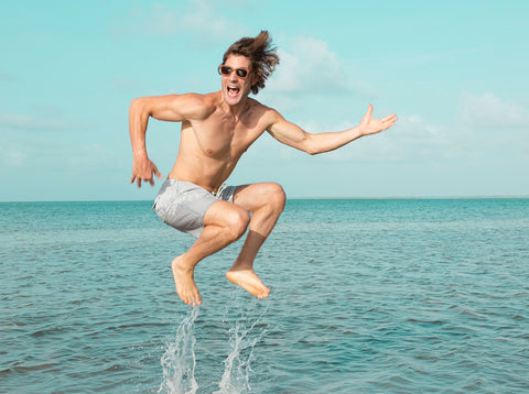 guy jumping at beach