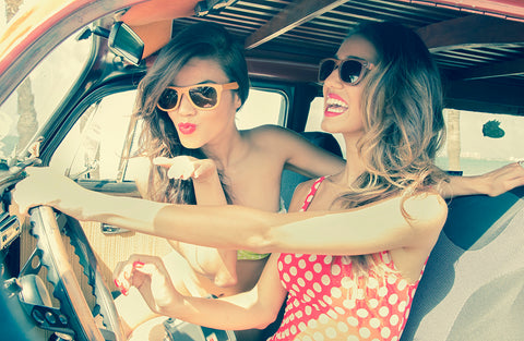 two girls having a great time driving