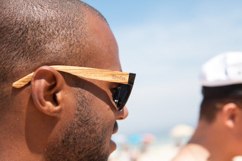 guy wearing wooden sunglasses