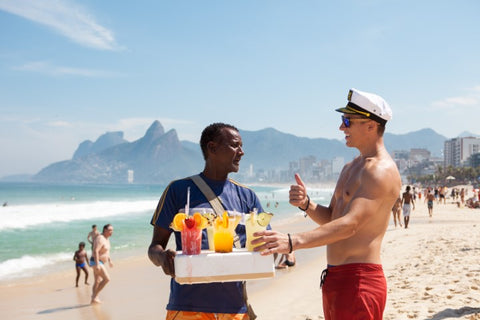 captain having some drinks from a beach vendor
