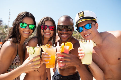 captain and friends enjoying their drinks at the beach