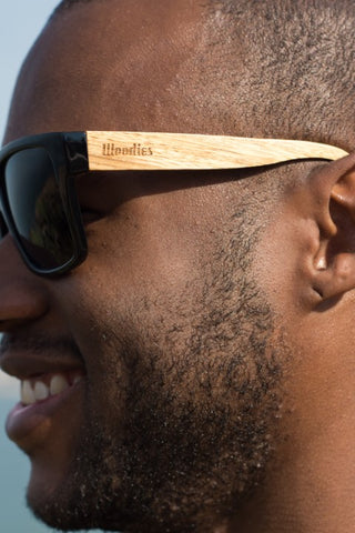 guy wearing wooden black shade sunglasses