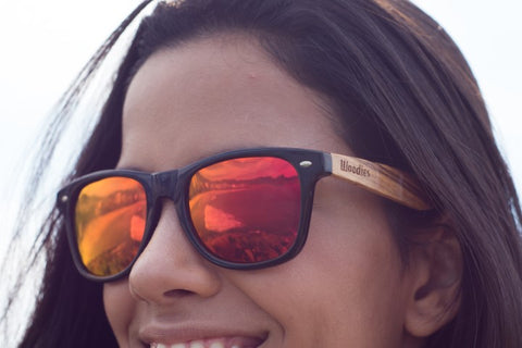 girl wearing red orange shade of sunglasses