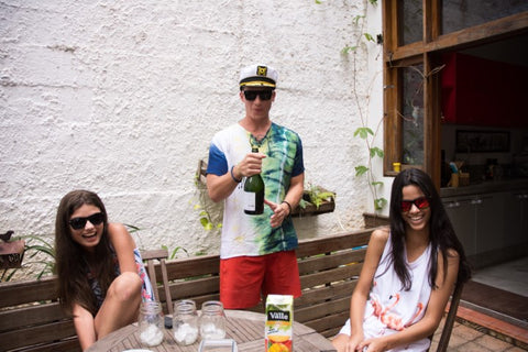 3 friends 1 guy 2 girls in sunglasses enjoying their drinks
