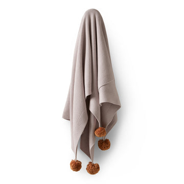 FAWN KNITTED BLANKET WITH POM POMS - Wilson and Frenchy