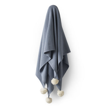 DUSTY BLUE KNITTED BLANKET WITH POM POMS - Wilson and Frenchy