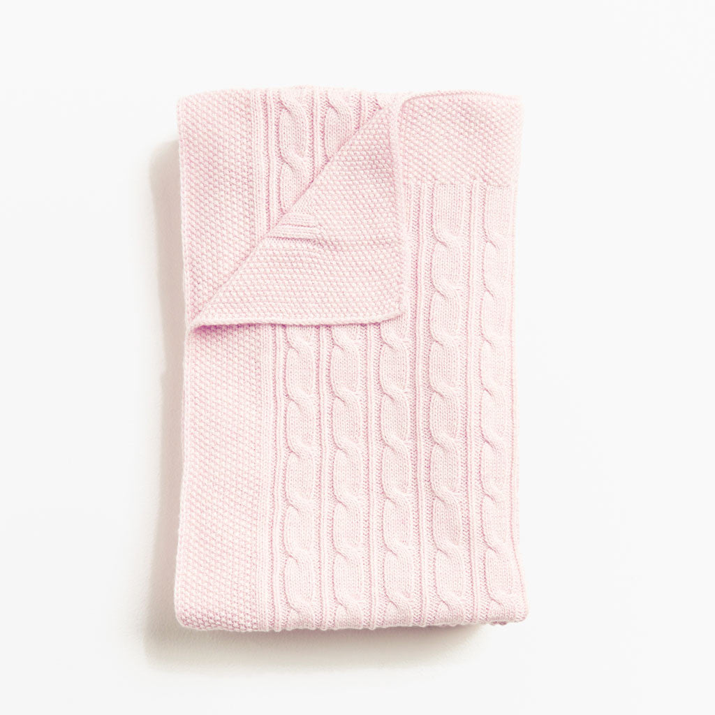 Powder pink cable knitted blanket