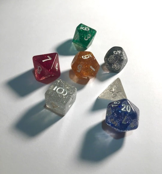 Koplow glitter, translucent 7 set polyhedral dice, assorted